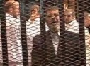 Video still shows ousted former Egyptian President Mursi in a courthouse on the first day of his trial, in Cairo