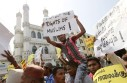 Sri Lankan Muslims shout slogans and carry placards during a protest against the government in Colombo