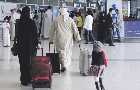 An Emirati family arrives at the Abu Dhabi International Airport in the capital, November 30, 2009.   Photo by Erik Arazas